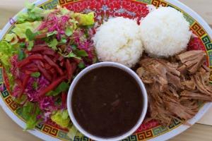 roast pork, white rice, black beans and a salad