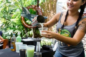 bartender serving drink at sip and stroll