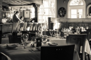 black and white image of interior dining room; click image to view gallery of restaurant photos
