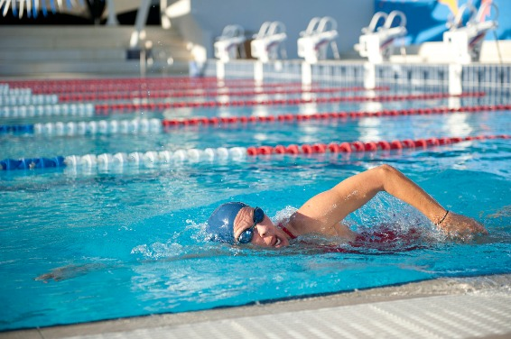 swimmer doing laps in a public swimming pool