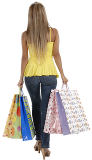 woman walking away with many shopping bags