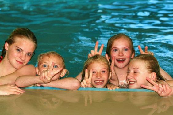 5 Girls having fun in a Public Swimming Pool
