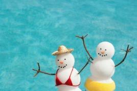 2 swimming snow people