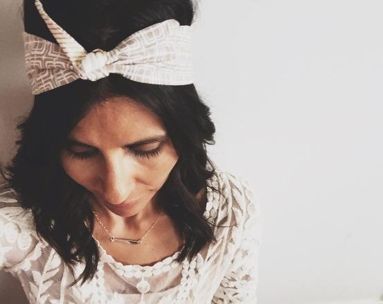 Leinani Designs owner Rebekah wearing an Ivy & Co. boho head wrap