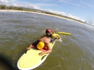 two men on surfboard