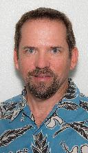 Don Oberheu, caucasian man with dark brown hair and beard wearing an aloha shirt.