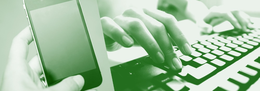 Hands on a computer keyboard.