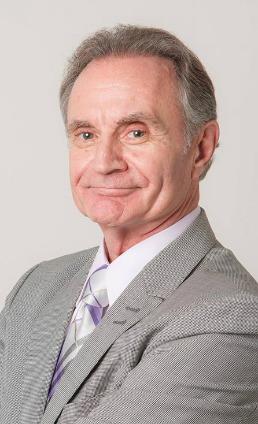Jim Bagnola in a gray suit.
