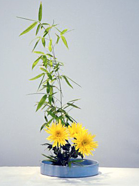 Three chrysanthemums and one branch of bamboo.