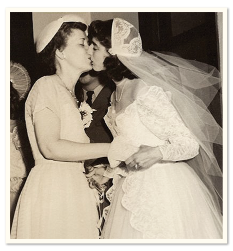 vintage photograph of two brides kissing