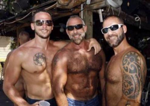 three shirtless men posing