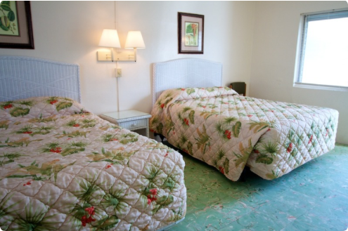Available rooms with two queen beds include refrigerator and private bath. Our rooms also feature original Cuban tile floors and jalousie windows. Make your reservation today 305-296-6531