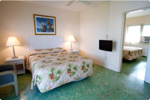 Available Two Bedroom Suites include one queen in each room, refrigerator and private bath. Our rooms also feature original Cuban tile floors and jalousie windows. Make your reservation today 305-296-6531