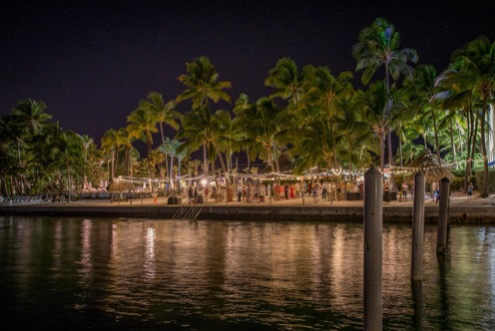 shot of amara cay resort from across the water at night