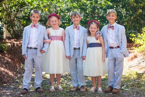 ring bearer and flower girl in custom coastal accessories