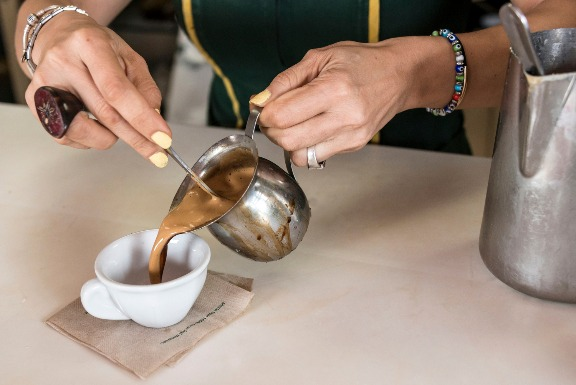 pouring a Cuban coffee in Little Havana