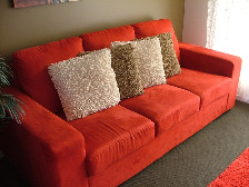 red 3 seater lounge suite