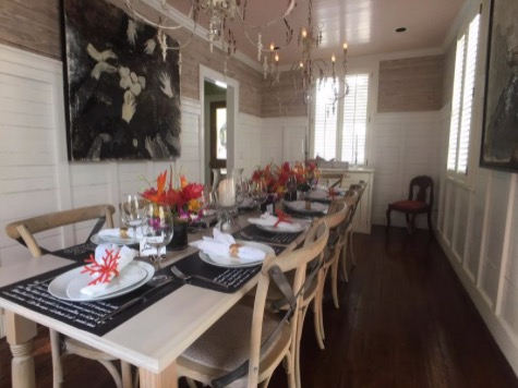 table is set in interior space of Isle Cook, ready for private event and tasting