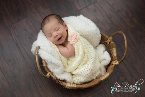 newborn photography photo smiling