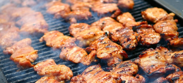 Barbecue chicken cooking on grill