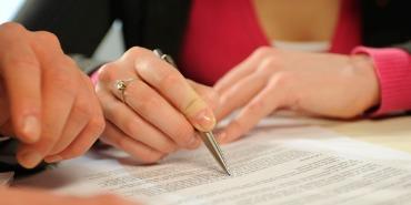 Hands, pen, contract